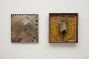 Edward Kienholz<BR>The American Way, II, 1960 and 1970<BR>paint and resin on rubber garden hose with severed deer neck mounted on wood;<BR>once covered with paint and watercolor on canvas (left image), subsequently removed by the artist (right image)<BR>22 3/4 x 22 1/4 x 8 in (57.8 x 56.5 x 20.3 cm)<BR>